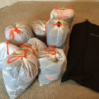 8 bags of clothes and 1 hanging bag