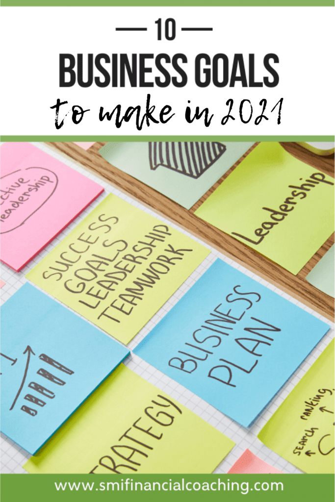 Business goals written on sticky notes on a table