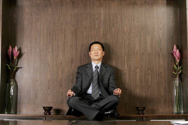Man in suit doing meditation
