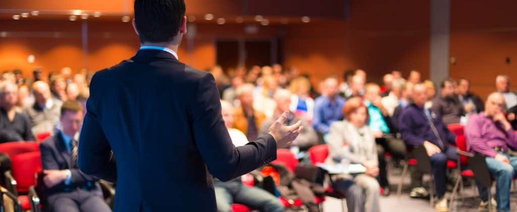 Speaker at Business Conference and Presentation with audience