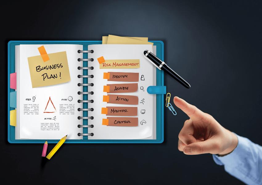 Planner notebook with a business plan written
