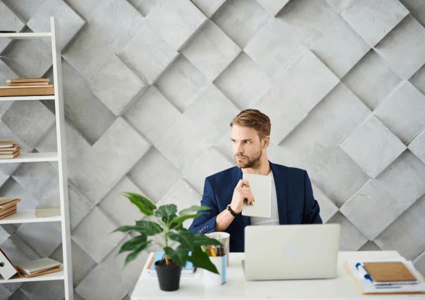 Entrepreneur creating a business plan on laptop