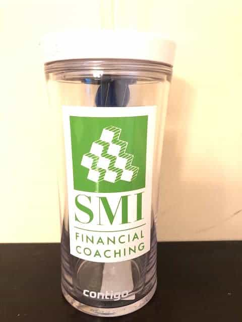 tumbler cup with a custom logo for a business conference