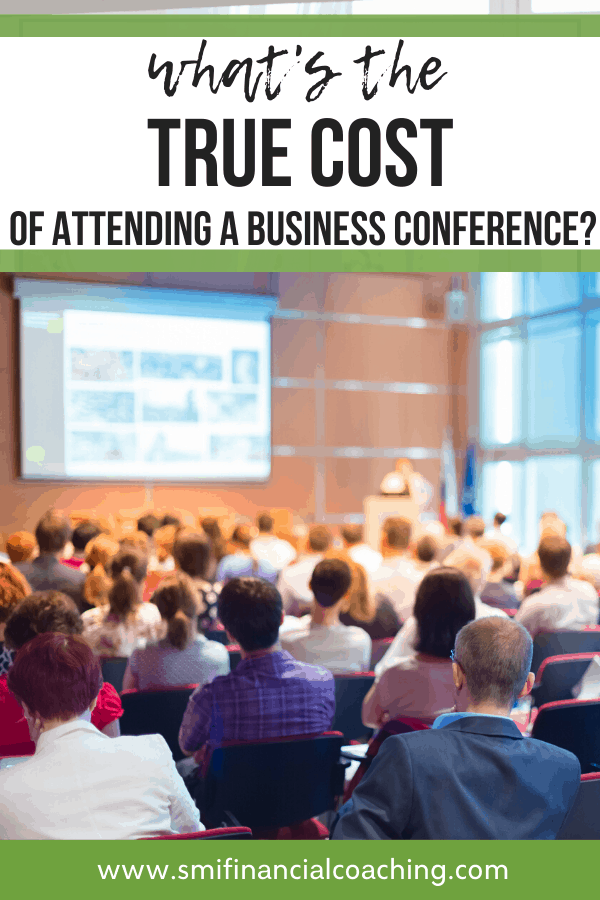 Image of a business conference with attendees