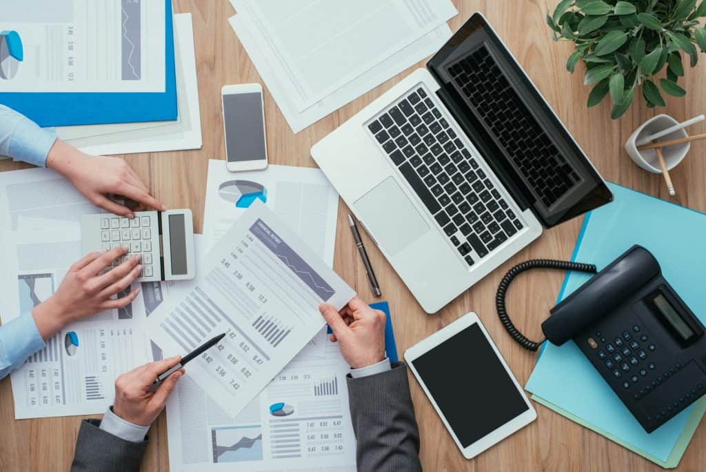 Business team working at office desk and analyzing financial reports and choosing the best accounting software for small businesses