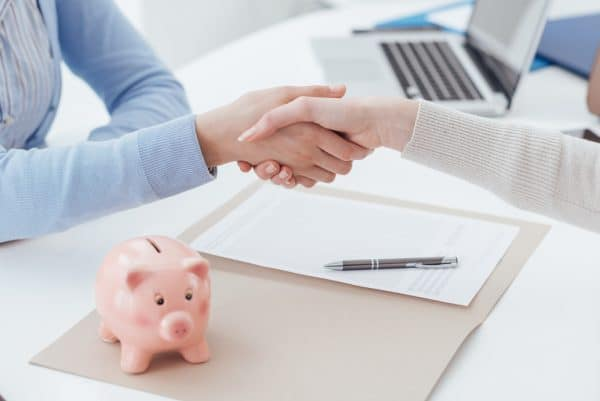 Financial planner shaking hands with new client