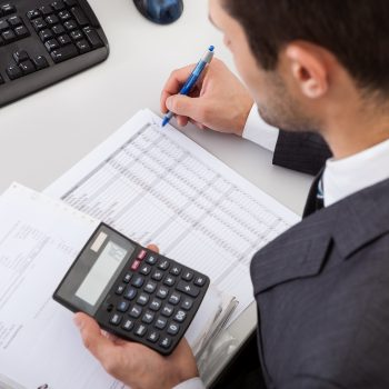 Small business accountant doing bookkeeping calculations