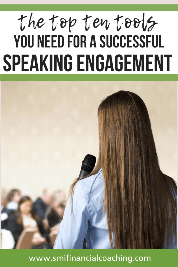 Woman with a speaking engagement taking to an audience