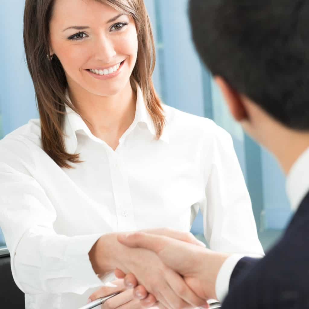 Entrepreneur shaking hands with client
