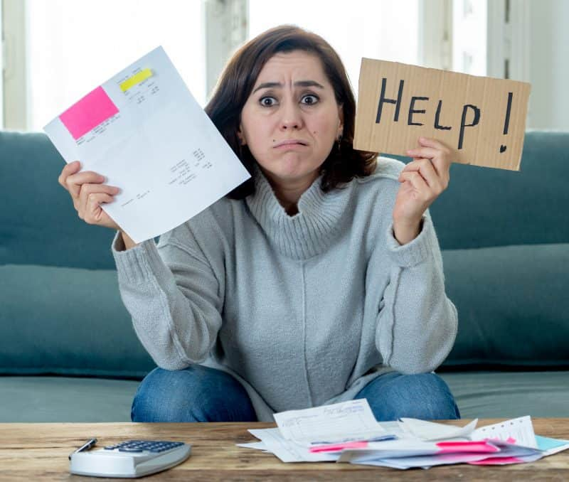 woman dealing with bills and financial anxiety
