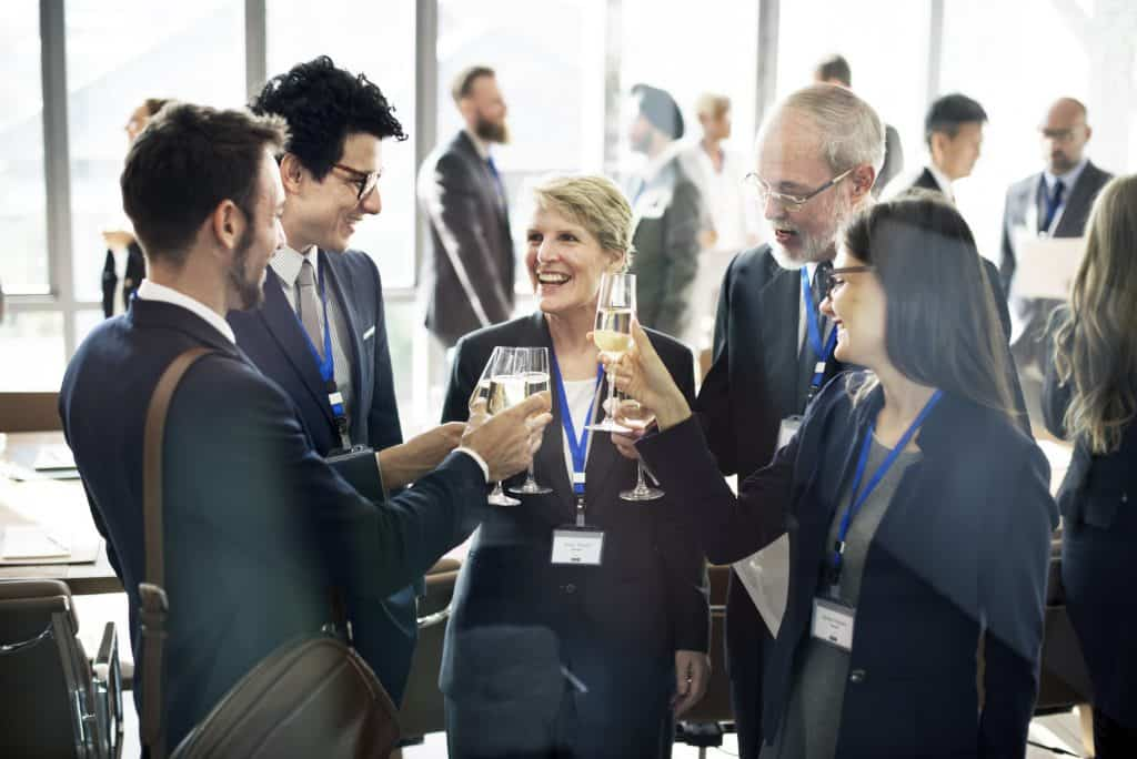 small business owners networking at a business conference.