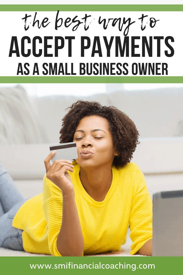 Woman holding a credit card as a small business owner