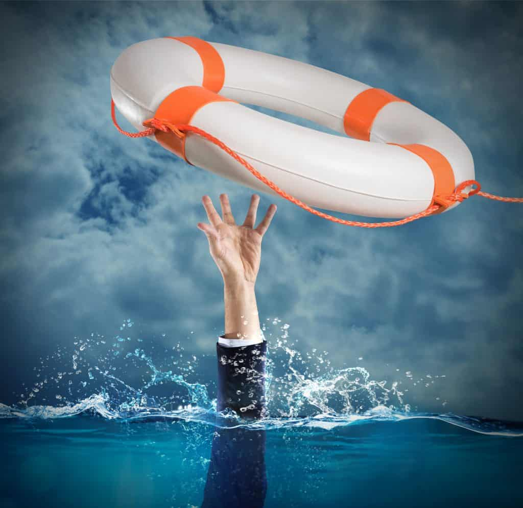 man reaching for a life preserver while drowning