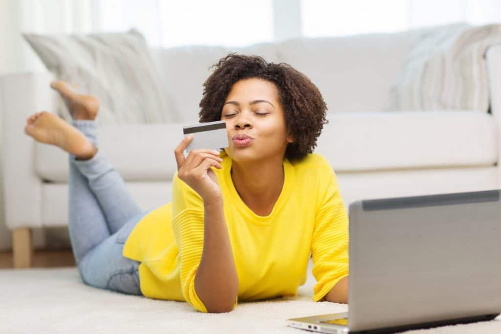 Woman making an online payment with a credit card