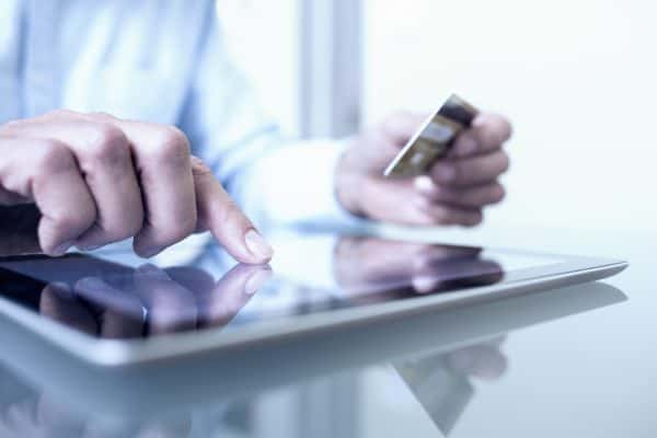 Man taking a credit card payment on an ipad app