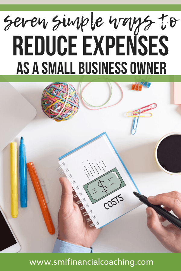 business owner writing down ways to reduce expenses